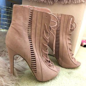 Pink peep toe lace-up heels